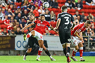 Bristol City's Nahki Wells (21) battles for possession with Swansea City's defender Brandon Cooper (16) during the EFL Sky Bet Championship match between Bristol City and Swansea City at Ashton Gate, Bristol, England on 20 August 2021.