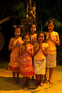 Elephant Hills Luxury Tented Camp in the rainforest in Southern Thailand. Local schoolgirls perform traditional Thai dance at the camp as entertainment in the evenings.