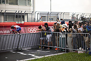 Fans watch as France's Remi Cavagna passes along the circuit during the men's cycling road individual time trial during the Tokyo 2020 Olympic Games at the Fuji International Speedway in Oyama, Shizuoka prefecture on July 28, 2021. - At the Fuji Speedway venue, around 100 kilometres (60 miles) from Tokyo, the rules on July 28 allowed for 10,000 spectators, less than half the venue's full capacity of 22,000. (Photo by Yuki IWAMURA / AFP)