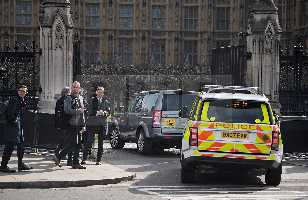 © Licensed to London News Pictures. 22/03/2018. London, UK. A convoy of vehicles carrying British Prime Minister THERESA MAY arrives through Carriage Gate at the Houses of Parliament in Westminster, London on the one year anniversary of the Westminster Bridge Terror attack in which lone terrorist killed 5 people and injured several more, in an attack using a car and a knife. The attacker, 52-year-old Briton Khalid Masood, managed to gain entry to the grounds of the Houses of Parliament and killed police officer Keith Palmer. Photo credit: Ben Cawthra/LNP