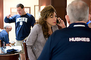 UConn President Susan Herbst speaks on the phone with women's basketball coach Geno Auriemma at the Hyatt Regency in Dallas, Texas before watching her school compete in the NCAA Final Four on April 5, 2014. (Cooper Neill / for The New York Times)