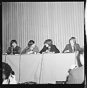 Y-650822A-02. Beatles at Memorial Coliseum press conference. August 22, 1965