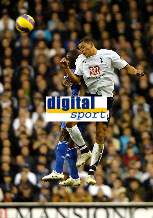 Photo: Ed Godden.<br /> Tottenham Hotspur v Chelsea. The Barclays Premiership. 05/11/2006. Jermaine Jenas (R) leaps high to win the ball.