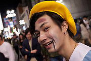 A man dressed as a elementary school student during the Halloween celebrations Shibuya, Tokyo, Japan. Saturday October 27th 2018. The celebrations marking this event have grown in popularity in Japan recently. Enjoyed mostly by young adults who like to dress up, drink , dance and misbehave in parts of Tokyo like Shibuya and Roppongi. There has been a push back from Japanese society and the police to try to limit the bad behaviour.