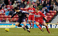 Photo: Leigh Quinnell.<br /> Middlesbrough v Manchester City. The Barclays Premiership. 31/12/2005. Man Citys Joey Barton escapes Middlesbroughs  James Morrison.