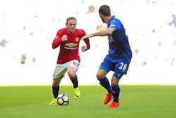 Wayne Rooney of Manchester United is challenged by Christian Fuchs of Leicester City - Rogan Thomson/JMP - 07/08/2016 - FOOTBALL - Wembley Stadium - London, England - Leicester City v Manchester United - The FA Community Shield.