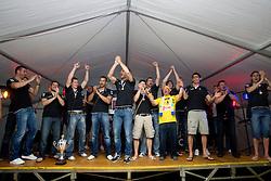 Vladimir Osmajic of Cimos Koper, Uros Rapotec of Cimos Koper, Robert Konecnik of Cimos Koper, Matjaz Brumen of Cimos Koper, Bojan Skoko of Cimos Koper, Ziga Smolnik of Cimos Koper, Dusan Podpecan of Cimos Koper, Sebastjan Skube of Cimos Koper, Jure Dobelsek of Cimos Koper, Fredi Radojkovic, head coach of Cimos Koper and Dean Bombac of Cimos Koper and fans celebrate  after the handball match between RK Cimos Koper (SLO) and SL Benfica (POR) in return final match of EHF Challenge Cup, on May 22, 2011 in Tent at Arena Bonifika, Koper, Slovenia. Koper defeated Benfica 31-27 and became Euro Challenge Champion 2011. (Photo By Vid Ponikvar / Sportida.com)