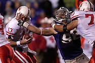 Kansas State defensive end Ian Campbell (98) fights off a block as he grabs Nebraska quarterback Zac Taylor's (13) facemask in the second half at Bill Snyder Family Stadium in Manhattan, Kansas, October 14, 2006.  The Huskers beat the Wildcats 21-3.<br />