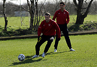 Photo: Paul Thomas.<br />Manchester United training session. UEFA Champions League. 06/03/2007.<br />Man Utd's Wayne Rooney is watched by Cristiano Ronaldo during training.