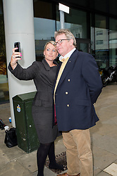 © Licensed to London News Pictures. 18/06/2014. Chelmsford, UK.  Comedian Jim Davidson poses for a picture with a fan as he  arrives at Chelmsford Magistrates Court in Essex, in a show of moral support for N-Dubz  pop group member Dino Costas Contostavlos who is accused of attacking a man in the early hours of 27 February and is due to stand trial. Photo credit Simon Ford/LNP