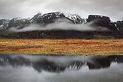 Fog clings to the mountains along the coast of South-East Iceland, near Jokulsarlon