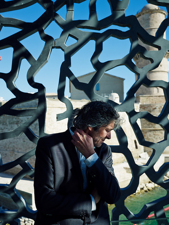 "MARSEILLE, FRANCE. MAY 3, 2013. Architect Rudy Ricciotti posing at the ""Mucem"", a sea museum he designed (to be opened in June 2013). Photo: Antoine Doyen"