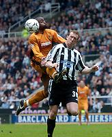 Photo. Glyn Thomas.<br /> Newcastle United v Wolverhampton Wanderers. <br /> FA Barclaycard Premiership. 09/05/2004.<br /> Newcastle's Steven Caldwell (R) battles for the ball with Shaun Newton.