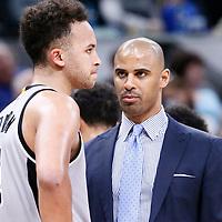 02 April 2017: San Antonio Spurs assistant coach Ime Udoka talks to San Antonio Spurs guard Kyle Anderson (1) during the San Antonio Spurs 109-103 victory over the Utah Jazz, at the AT&T Center, San Antonio, Texas, USA.