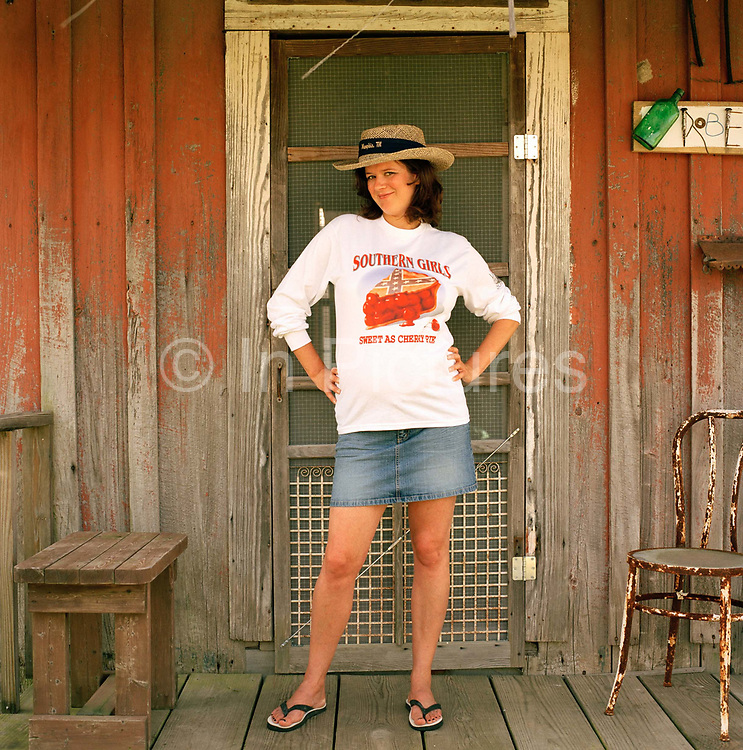 Jounalist, Katy Regan, 4 months pregnant, posing outside a refurbished cotton planters shack at the Shack Up Inn whilst on a road trip of the American southern states. If you want to explore Clarksdale and the Blues country in true retro fashion the best place to do so is by staying at the Shack Up Inn.