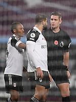 Football - 2020 /2021Premier League - West Ham United vs Fulham - The London Stadium<br /> <br /> referee Rob Jones speaks to Fulham's Aleksander Mitrovic.<br /> <br /> COLORSPORT/ASHLEY WESTERN