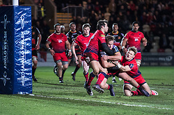 Dragons' Jarryd Sage is stopped short of the try line but forces himself over for the first try of the game.<br /> <br /> Photographer Simon Latham/Replay Images<br /> <br /> Anglo-Welsh Cup Round Round 4 - Dragons v Worcester Warriors - Friday 2nd February 2018 - Rodney Parade - Newport<br /> <br /> World Copyright © Replay Images . All rights reserved. info@replayimages.co.uk - http://replayimages.co.uk