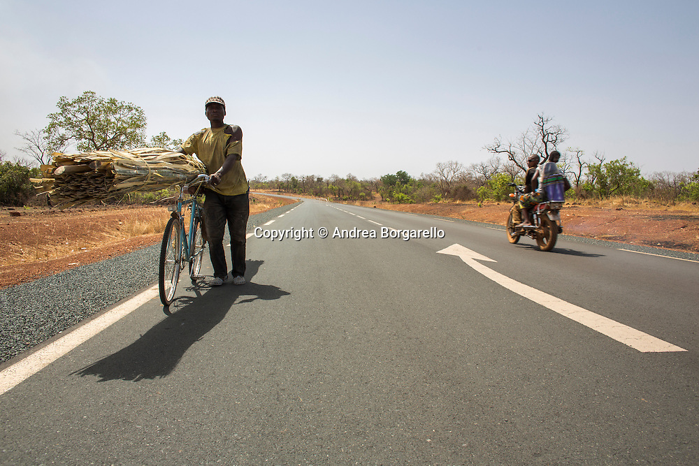 """On the road: The new Southbound Bamako-Dakar Corridor, approximately 1,000 km in length, drastically changed the way the surrounding communities access goods and services. """"They started building the gas station 2 months ago because of the new road. Before, people needed to travel 90km to find gas."""" Resident, Tambacounda"""