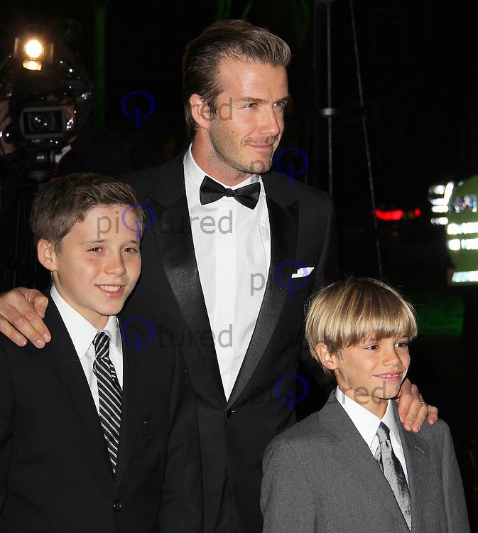 LONDON - DECEMBER 19: David Beckham; Brooklyn Beckham; Romeo Beckham attend the The Sun Military Awards 'The Millies' at the Imperial War Museum, London, UK on December 19, 2011. (Photo by Richard Goldschmidt)