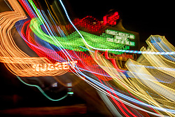 """""""Tahoe Lights 4"""" - Photograph taken at the Lake Tahoe northern state line casinos. The look was achieved by shooting a handheld long exposure and zooming the lens during the exposure."""