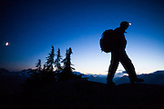 Ian Derrington hikes Salvation Peak by headlamp in North Cascades National Park, Washington.