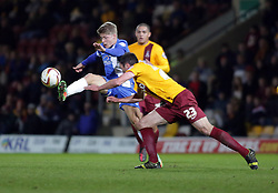 Peterborough United's Lloyd Isgrove in action with Bradford City's Rory McArdle  - Photo mandatory by-line: Joe Dent/JMP - Mobile: 07966 386802 18/04/2014 - SPORT - FOOTBALL - Bradford - Valley Parade - Bradford City v Peterborough United - Sky Bet League One