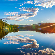 Nothing has been added or removed. (No PS mirror).Reflection over the beautiful lake of Leirsjøen in Trondheim.   Store Leirsjøen or Greater Leirsjøen located in Leirelvvassdraget in Trondheim Bymark . Leirsjøen was originally separated from Frøset lake in the east, but by damming in 1929 floated the waters.d