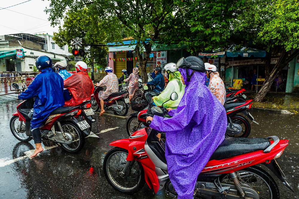 Motorcyclists bundled up in the rain, Hue, Central Vietnam.