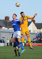 Newport County's Robbie Willmott vies for possession with Portsmouth's Jed Wallace<br /> <br /> Photo by Kevin Barnes/CameraSport<br /> <br /> Football - The Football League Sky Bet League Two - Newport County AFC v Portsmouth - Saturday 29th March 2014 - Rodney Parade - Newport<br /> <br /> © CameraSport - 43 Linden Ave. Countesthorpe. Leicester. England. LE8 5PG - Tel: +44 (0) 116 277 4147 - admin@camerasport.com - www.camerasport.com