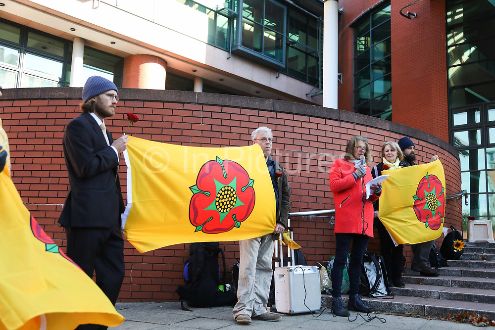 """Gina Dowding speaks outside Preston Crown Court where family, friends and supporters have gathered to a quiete and respectful show of solidarity using roses to symbolise the Lancashire Rose September 25th, Preston, Lancashire, United Kingdom. Simon Roscoe Blevins, 26,  Richard Roberts, 36 were both sentenced 16 months in prison, Richard Loizou, 31, sentenced 15 months in prison and  and Julian Brock, 47 12 months supended. Simon Roscoe Blevins, 26,  Richard Loizou, 31, Richard Roberts, 36 and Julian Brock, 47 climbed on top of several trucks during a mass protest by locals and supporters in New Preston Road, against fracking in Lancashire, July 2017. The trucks were prevented form delivering equipment to Cuadrillas nearby fracking site for four days. After a seven day jury trial at Preston Crown Court in August 2018, the four men were found guilty of Public Nuisance. Judge Altham has told them to expect """"immediate custodial sentences"""" on 25th September 2018."""