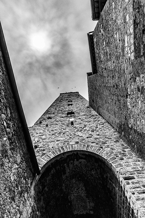 Torre Grossa in San Gimignano in Tuscany, Italy.   Attached to Palazzo Comunale, the 54-metre Torre Grossa is San Gimignano's highest tower. It was built between 1300 and 1311 and is one of seven towers surrounding Piazza del Duomo. However, it is the only one of San Gimignano's towers that is open to the public with access provided through il Museo Civico.