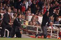 Arsene Wenger and Alex Ferguson show different emptions on the sidelines. Arsenal v Manchester United, FA Premiership, 16/04/2003. Credit: Colorsport / Andrew Cowie