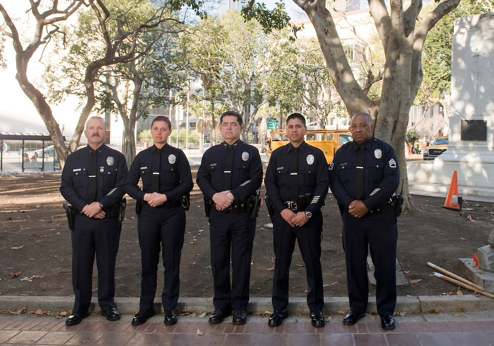 """Members of the Los Angeles Police Department """"Occupy"""" command staff Commander John Sherman, left, Margarita Balchowsky,  Deputy Chief Jose Perez, Officer Orlando Nieves and Sergeant James Baker III."""