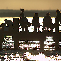 (DAYIN) Lavallette 7/72004   Sunset on the Barnegat Bay as crabbers try there luck for dinner.    Michael J. Treola Staff Photographer....MJT