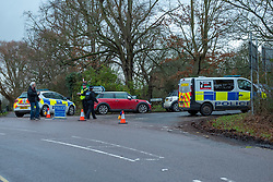 © Licensed to London News Pictures. 21/12/2019. Borehamwood, UK. Police vehicles form a cordon on Hogg Lane after Hertfordshire police were called to the discovery of a man's body on Friday 20th December around 15:38 GMT. London's Metropolitan Police are investigating and are linking the death to the murder of a man found with stab injuries in Scratchwood Park, Barnet in London on 19th December 2019. Photo credit: Peter Manning/LNP