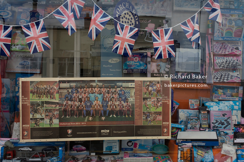 Football team poster from a local newspaper on display in the window of a Cheltenham toyshop, Gloucestershire, England.