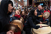 The band members get super excited playing music during one of the lion performances  at the Chinese New Year Parade. ( photo by- Pamarthy Akash, taken on Feb 10th 2019)