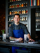 Bobby Benjamin, Chef and Owner of Butchertown Grocery, poses for a portrait inside his restaurant.