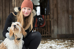 Portrait of teenage girl with dog, Bavaria, Germany
