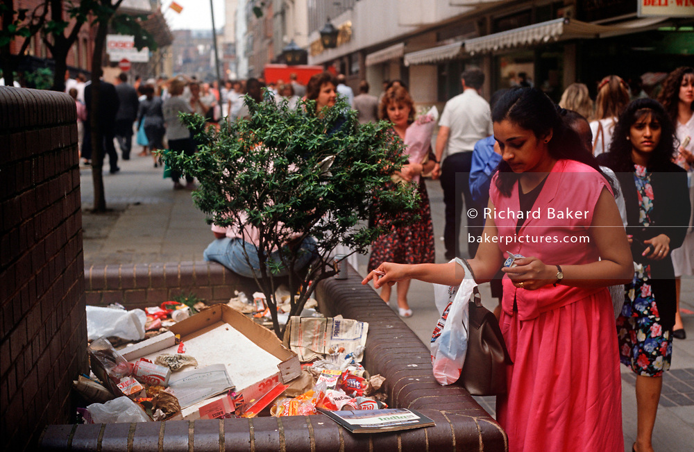 A lady drops a piece of litter on a growing pile of rubbish in a London shopping centre, on 15th June 1999, in London, England. (Photo by Richard Baker / In Pictures via Getty Images)