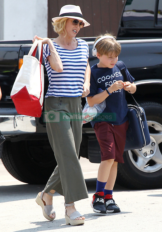 Ed O'Neill and Julie Bowen on the Set of Modern Family. 09 Aug 2018 Pictured: Julie Bowen, Oliver McLanahan Phillips. Photo credit: TRF Images /MEGA TheMegaAgency.com +1 888 505 6342