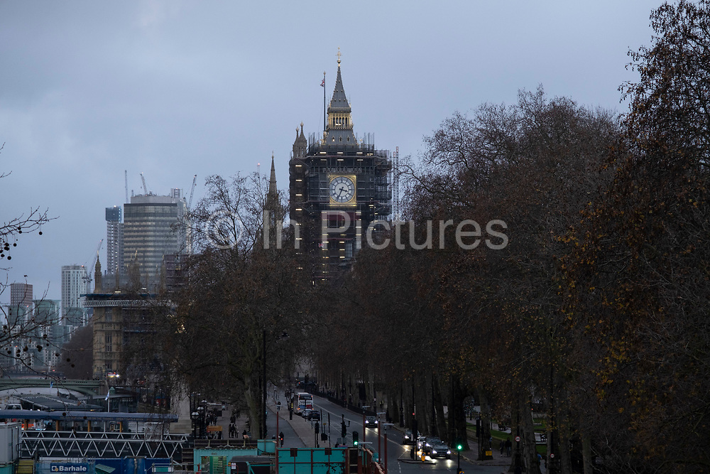 View of the Houses of Parliament in Westminster as the Prime Minister announces a new tighter fourth tier of local coronavirus restrictions for London and the South East, and that the planned Christmas relaxation of the rules was to be scrapped on 19th December 2020 in London, United Kingdom. These shoppers, mostly wearing face masks were unaware, as were shop owners that the new rules were about to be announced, and this would mean that all non-essential shops will have to close from midnight.