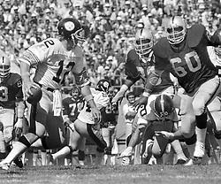Oakland Raiders lineman #60 Otis Sistrunk puts rush on Steeler QB Terry Bradshaw. (1976 photo by Ron Riesterer)
