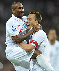 England's Jermain Defoe (left) celebrates scoring their fifth goal with team mate and captain John Terry.