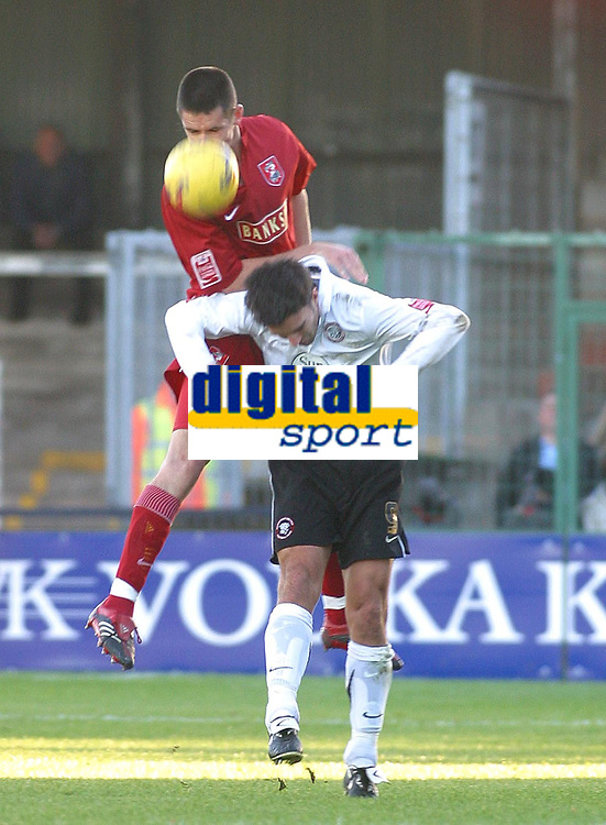 Photo: Dave Linney.<br />Hereford United v Walsall. Coca Cola League 2. 18/11/2006. Walsall's Scott Dann(Top)  gets a lift from  Tim Sills.