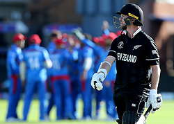 New Zealand's Colin Munro watches the big screen after being caught out by Afghanistan's Hamid Hassan during the ICC Cricket World Cup group stage match at the County Ground Taunton.