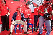 "26 MARCH 2009 -- BANGKOK, THAILAND: Veera Musigapong, a leader of the United Front of Democracy Against Dictatorship (UDD), waits to speak at a UDD rally in Bangkok. More than 30,000 members of the United Front of Democracy Against Dictatorship (UDD), also known as the ""Red Shirts""  and their supporters gathered on Sanam Luang (the vast open field in front of the Palace) and descended on central Bangkok March 26 to start a series of protests against and demand the resignation of current Thai Prime Minister Abhisit Vejjajiva and his government. The protest is a continuation of protests the Red Shirts have been holding across Thailand. Thaksin was deposed in a coup and went into exile rather than go to prison after being convicted on corruption charges. He is still enormously popular in rural Thailand.  PHOTO BY JACK KURTZ"