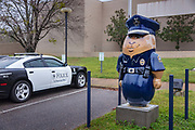 Police station with 5-foot-tall peanut sculptures of policeman on 5th March 2020 in downtown Dothan,  The Peanut Capital of the World, Alabama, United States of America.