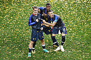 France forwarder Antoine Griezmann (L) , France forwarder Kylian Mbappe (R) and France midfielder Paul Pogba (C) showing the 2th star on the shirt of Griezmann after winning the 2018 FIFA World Cup Russia, final football match between France and Croatia on July 15, 2018 at Luzhniki Stadium in Moscow, Russia - Photo Stanley Gontha / Proshots / ProSportsImages / DPPI