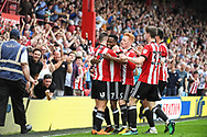 Brentford Midfielder Florian Jozefzoon (7) celebrates scoring a goal (2-1) during the EFL Sky Bet Championship match between Brentford and Queens Park Rangers at Griffin Park, London, England on 21 April 2018. Picture by Stephen Wright.